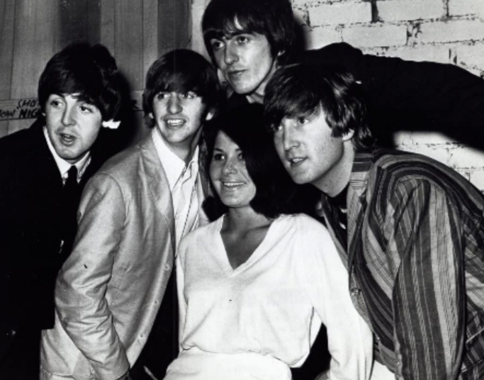 Cherry Roland pictured with the The Beatles.