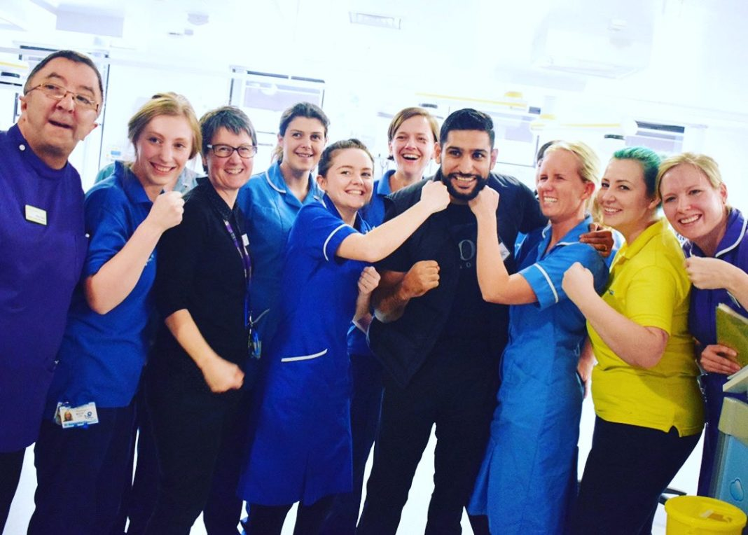 Amir Khan with NHS staff in his hometown of Bolton