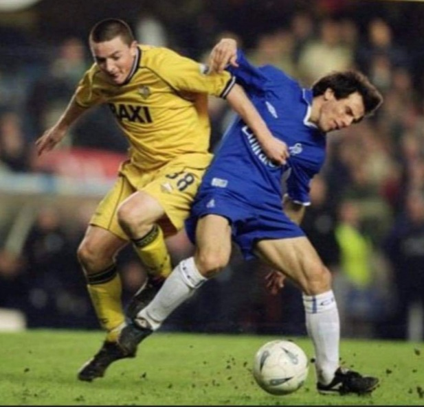 Keano in action for Preston North End against Gianfranco Zola of Chelsea.