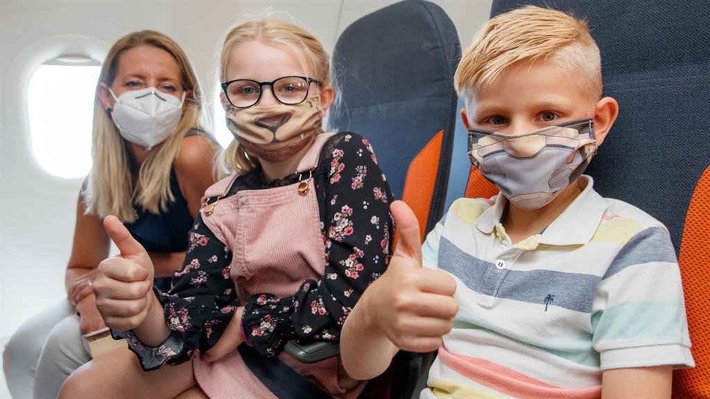 Spider Man and Star Wars masks for children as flights resume.