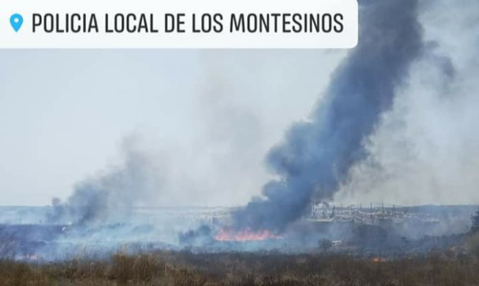 Helicopter, Bomberos and police attend fire in Montesinos