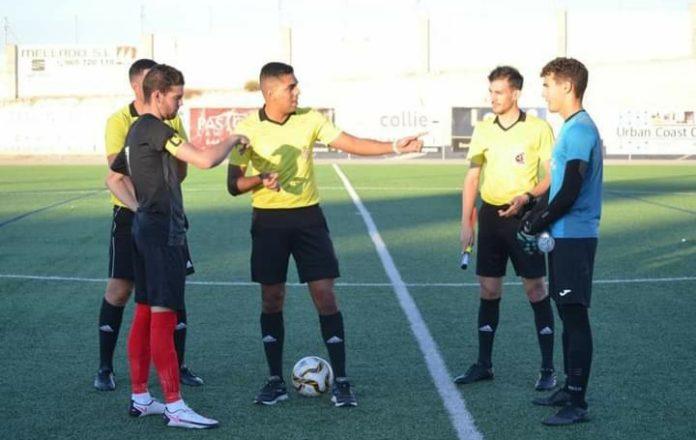 Racing San Miguel captain Gabriel (left) against CD Horadada.