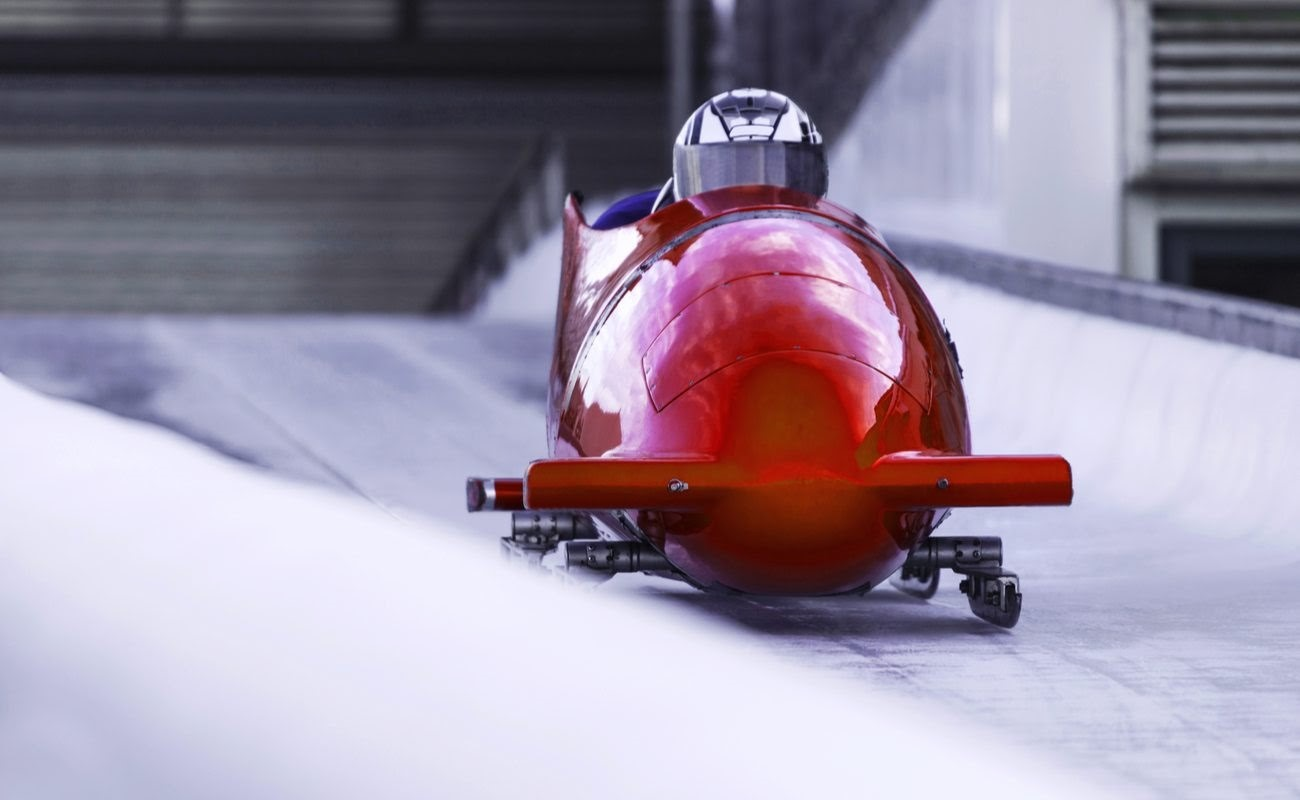 Red bobsled in an ice channel