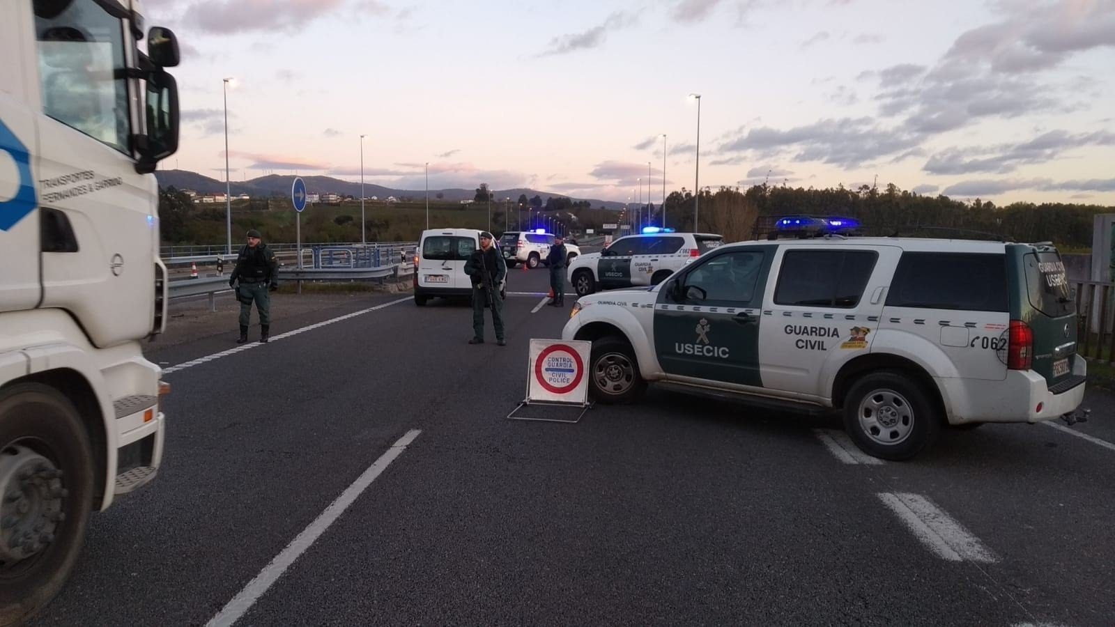 A police roadblock stopping traffic leaving Madrid