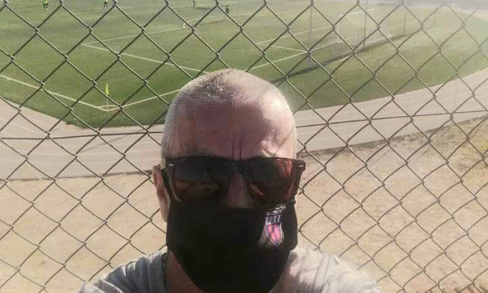 Racing San Miguel masked fan Steve Dobson watched Racing v Catral CF outside the stadium, due to COVID-19 behind closed doors protocol.