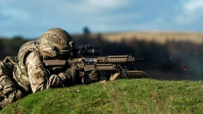Semi-anonymous Army Reserve soldier of 6th Battalion, The Royal Regiment of Scotland, firing a L129A1 Sharpshooter Rifle during the regiment's annual two we