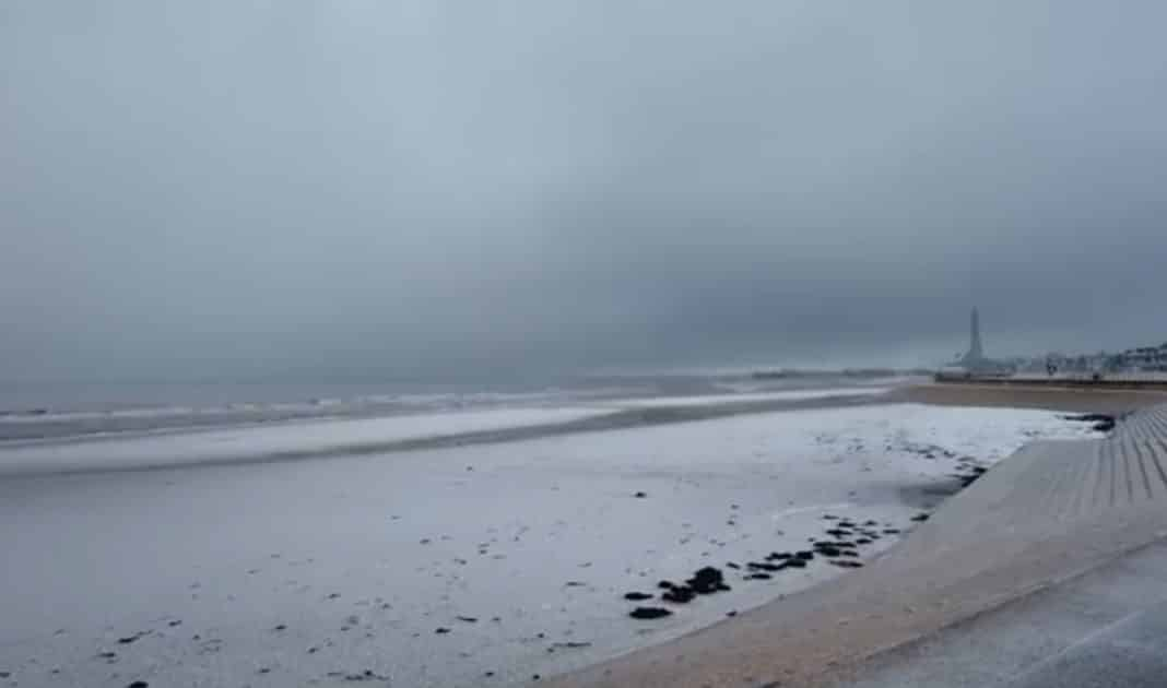 Snow and hail on Blackpool beach (Blackpool Tower barely visible in distance) with dark clouds over the sea. Photos: A Walk on The Wildside