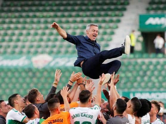 Elche celebrate with their manager, Fran Escribá