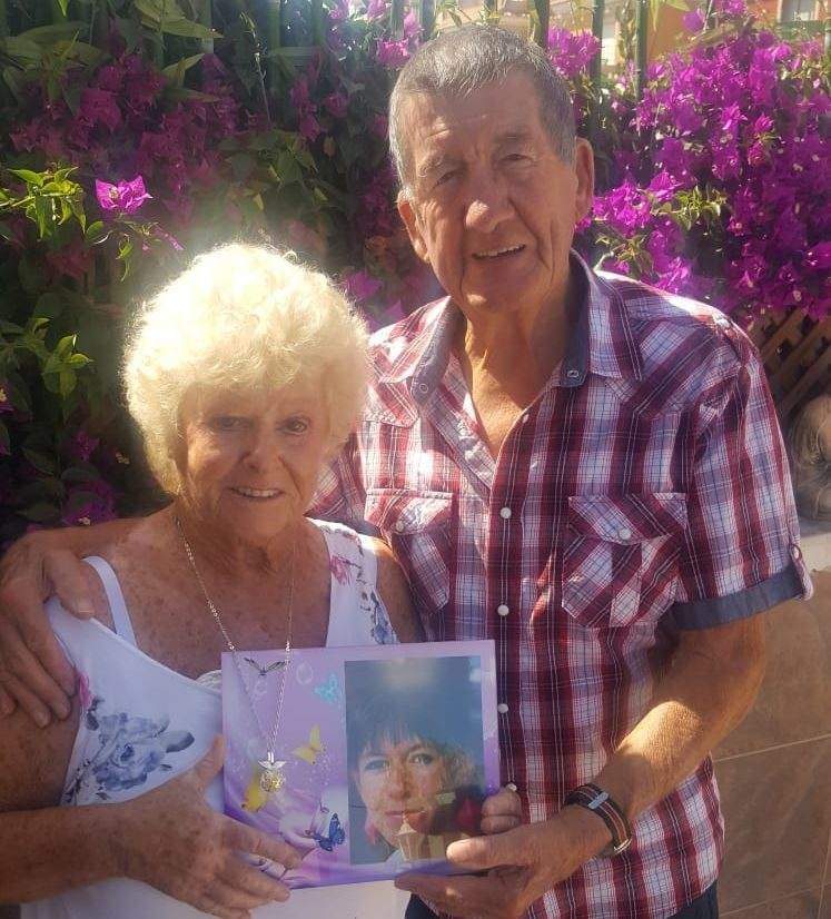 Brenda and George Stanhope with a photograph of daughter Bev.