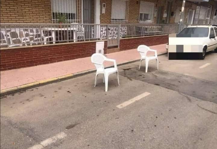Chairs placed onto roads to reserve car parking is illegal.