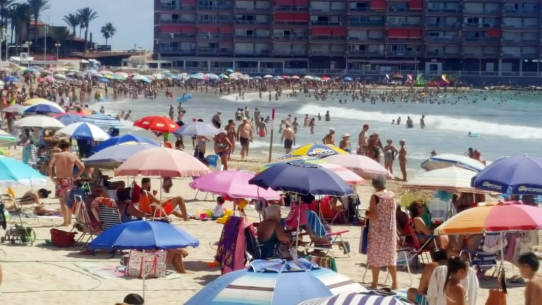 During July 1-21, 2,065 people arriving in Britain from Spain tested positive for Covid-19. Torrevieja beach full to capacity. Photo: Andrew Atkinson