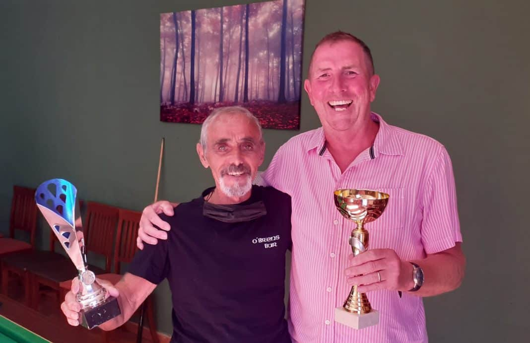 Terry Woolley (OBrien's) and Kim Oswell (Laguna Tavern) with the Mini Winter Pool League runners-up and winner's Trophies. Photo: Helen Atkinson.